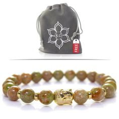 "Kanti Design Unakite Buddha Bracelet - Gemstone Yoga Bracelet for Men or Women - Goldtone. Beauty and Function - Unakite has been called the stone of visions, it has a gentle energy that emanates spiritual growth. Naturally appealing Unakite is a mottled green and peach/pink smooth stone. Unakite is said to lift your spirits when you are feeling down - this is the gemstone to help you to see the beauty in life. Here is what Cher stated in her review: ""I love that it compliments any outfit..."