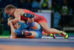 Canada's Erica Wiebe, in red, competes against Kazakhstan's Guzel Manyurova during the women's 75kg freestyle wrestling competition at the 2016 Summer Olympics in Rio de Janeiro, Brazil, Thursday, Aug. 18, 2016. (COC/Jason Ransom)