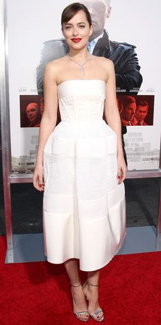 Dakota Johnson was a vision at the Boston premiere of Black Mass in an ivory strapless corseted creation that she styled with a diamond necklace and delicate silver sandals.