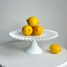 We have two of these milkglass cake stands in our inventory.  Add your own lemons.  =)