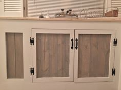We built these cabinets out of pinewood. The outer boards are painted white, the inner boards have a weathered oak stain on them. We added rustic cast iron knobs and pulls for a pop of contrast. Oak Stain, Air B And B, Smoky Mountain, Weathered Oak, Diy Cabinets, Knobs And Pulls, Dandridge Tennessee, Beach House, Rustic