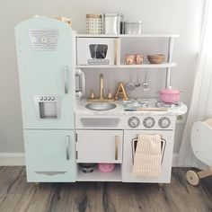 For those wanting a close up of Aniston's kitchen. And the details- @kidkraft_lp vintage white kitchen. Painted the fridge mint green. Put marble contact paper on the counter top. Sprayed the faucet gold and some of the handles. (Ordered different handles but got the wrong size ) Accessories from @westelmindianapolis @anthropologie and @thecontainerstore  #odlehouselove