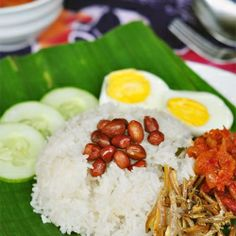 A favourite dish in Malaysia and Singapore - Nasi Lemak with Sambal Chili - You can never say NO to this!