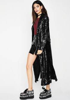 Magic Tricks Sequin Kimono cuz you know exactly how to work your charm. This sequin kimono has a longline fit and a belted waist.
