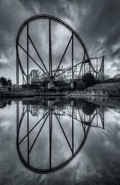 Roller coaster reflections in the pond at the abandoned Camelot Theme Park, by Joe Holland