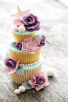 An easy idea for a mini cake would be to stack two cupcakes and add a smaller third cupcake and even decorate around the bottom on the plate