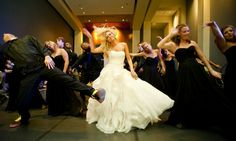 Bride dancing in a sea of black