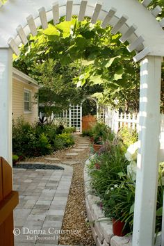 This photo has some similarity to my cottage home...it's giving me some great ideas.  I love the yellow and white!  I'm working on a garden path now, and really like this gravel.