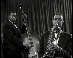 """1956: Eric Dolphy playing baritone sax in """"Rock All Night"""" Rock all Night frames"""