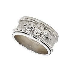 Why not go for added sparkle with this lovely women's 9ct white gold wedding band, featuring three brilliant cut diamonds in a contemporary rubover setting, but given a touch of classic styling with some romantic swirls.