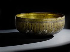 An Artuqid silver-inlaid brass basin made for Sultan Qara Arslan Ibn Il Ghazi, from Mardin, Anatolia, second half of the 13th century