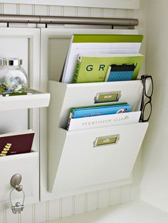 Wall-mounted file holder.