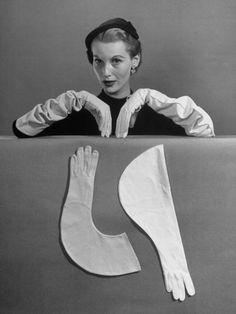 Model Modeling Elbow Length Gloves    by Nina Leen