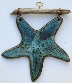 Ceramic starfish and driftwood decoration