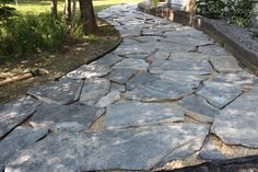 Placement of flagstone walkway before filling the joints.