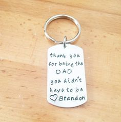 "Personalized Step Dad Keychain, Gift For Step Dad. Hand Stamped Personalized Dog Tag Keychain for Step Dads Hand Stamped with ""thank you for being the DAD you didn't have to be"" and then Heart Symbol and Name or names of choice. Made of Pure Aluminum Heavy Duty 14 Gauge."