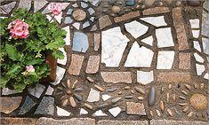 Use rocks and broken pottery to make a mosaic path