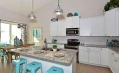 "Cottage Kitchen with 24"" Bar Stool by Flash Furniture, Bianco Crystal Granite Countertop, White Subway Tile"