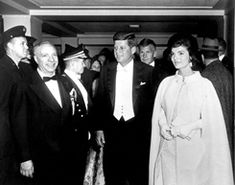 AR6281-D President and Mrs. Kennedy arrive at National Guard Armory for Inaugural Ball, 20 January 1961.