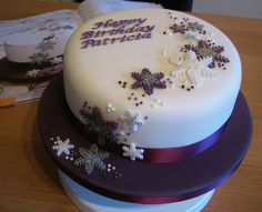 Purple winter snowflake cake