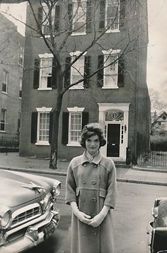 Jackie in front of her and JFK's first townhouse in Georgetown.