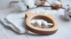 A wooden bear teether made of beech and covered with linseed oil is the ideal first toy for babies to grasp and chew. Sanded perfectly smooth. When the baby shakes the rattle teether, the wooden linden beads make a gentle clacking sound. A unique gift for new parents and their new little ones. Materials: beech, linden, covered with linseed oil. Size: 4x4x0.5 inch (10х10х1,4 cm) 100% handmade. Our toys help to develop: - fine motor and speaking skills; - imagination and creativity; - taste…