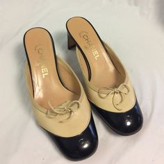 Selling this Authentic Chanel beige and black leather slide ons in my Poshmark closet! My username is: b287807. #shopmycloset #poshmark #fashion #shopping #style #forsale #CHANEL #Shoes