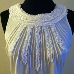 Chic white cotton halter neck t shirt with ruffles Vacation is Near! Resort Season is Here! This white cotton sleeveless tank is a must have essential for a chic resort vacation wardrobe. Size Medium Tops Tees - Short Sleeve