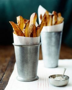 Styling Tip: Put ordinary things in extraordinary vessels. The fries look great in the mint julep cups! I wish there was one more in the left back.