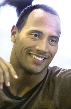"""Dwayne """"The Rock"""" Johnson I'm not all that crazy about big muscles, I think this man has a wonderful smile, which makes him sexy!!! He still looks great with muscle's :)"""
