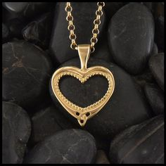 Beaded milligrain heart pendant in gold with triquetra.