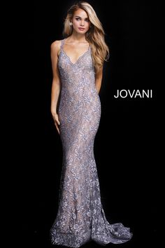 05695dc662 Catch someone s eye in Jovani 54853. This alluring lace gown has a  delicately scalloped V