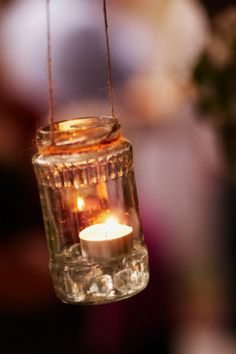 Pop tea lights in clear jars and string them up with twine for a simple and effective way to create a warm glow. Plus, they won't blow out if it gets windy!