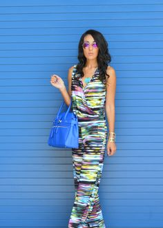 Summer look: pink aviators, turquoise tribal necklace, colorful jumpsuit, gold cuff, royal blue handbag