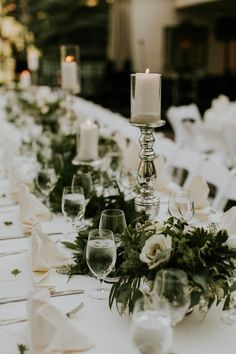 Elegant white, silver, and green reception table decor | Image by Joel Bedford Weddings
