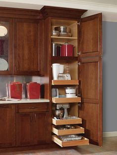 Decora's Utility Cabinet with Roll Trays provides easy access to contents. Shown here with cookware and small appliances, but also great in the kitchen as a pantry! #DecoraStorageSolutions