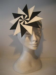 These origami styled fascinators just blow me away... Made by Ruby Martini