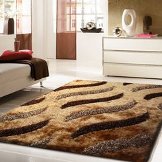 Soft and Luxurious, these rugs combine a multi level pile and tonal colors that are sure to please.And it's brown hand crafted designs are truly a work of art.It measures 2' x 3' ft. http://rugaddiction.com/collections/all-shag-rugs/products/shaggy-brown-hand-tufted-rug
