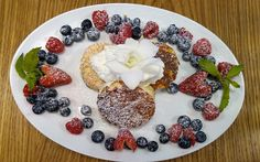 """For three palm-size """"Very Berry"""" ricotta soufflé pancakes, you'll fork over $17."""