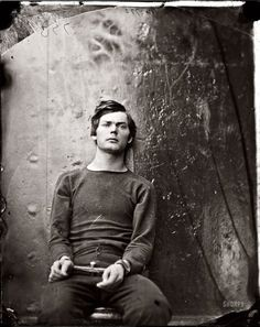 Lewis Payne, seated and manacled, at the Washington Navy Yard about the time of his 21st birthday in April 1865, three months before he was hanged as one of the Lincoln assassination conspirators.