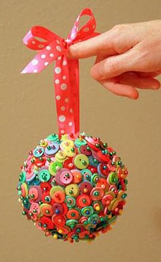 This is so fun! Buttons and straight pins in a Styrofoam ball.