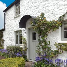 Some shelter for the postie. The pretty arched door canopy on this white painted rustic cottage is by Garden Requisites, Bath, England Arched Front Door, Front Door Canopy, Porch Canopy, Front Door Porch, Window Canopy, Awning Canopy, Arched Doors, Canopy Bedroom, Backyard Canopy