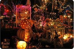 Another shot of the Fanicful Twist Halloween table. I want the glass house in the middle- I could fill it with so many magical things!