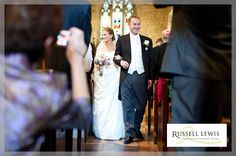 Bride and groom walk up the aisle at St Peter's Church in Little Comberton, near Pershore, in Worcestershire