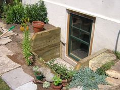 egress window wells | ... home gallery timber wells exterior timber wells wood well with flowers