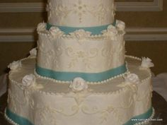 Wedding Cakes- 3 tier, buttercream, flower shaped, blue fondant ribbons, sugar roses, swans topper- 2