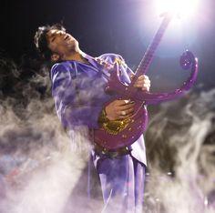 can yall post prince playing guitar pics