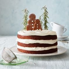 This gingerbread layer cake is easy to bake and decorate: Use cookies, sugar, rosemary sprigs and fluffy frosting to create a snow globe scene on top. Holiday Baking, Christmas Desserts, Christmas Treats, Christmas Baking, Christmas Candles, White Christmas, Christmas Gingerbread, Holiday Cakes, Cupcakes