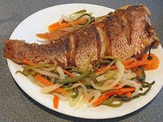 how too cook fried Red snapper & escovitch Jamaican Escovitch Fish Recipe, Fish Recipes Jamaican, Jamaican Cuisine, Jamaican Dishes, Whole Red Snapper Recipes, Whole Fish Recipes, Fried Fish Recipes, Fried Whole Fish, Seafood