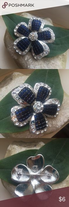 Vintage Blue Silver Flower Brooch Vintage Blue Silver Flower Brooch Dark blue with clear rhinestones  About 1 1/2 inches wide and tall Very pretty!  Thanks for looking and please check out the rest of my closet! 🐞 Vintage Jewelry Brooches